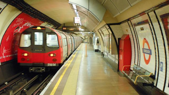 A subway train at a train station